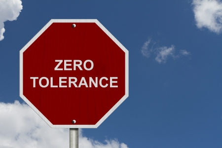 Zero Tolerance Sign, An American road warning sign with words Zero Tolerance with blue sky
