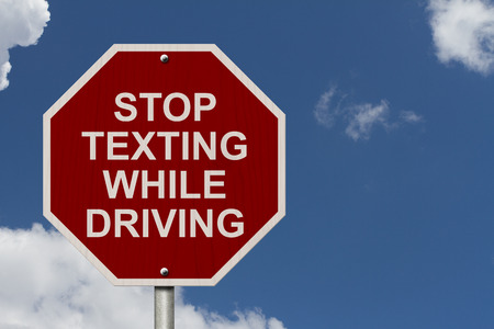 Stop Texting While Driving Sign, Red and White Stop sign with words Stop Texting While Driving