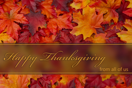 Happy Thanksgiving Greeting, Fall Leaves Background and text Happy Thanksgiving from all of us