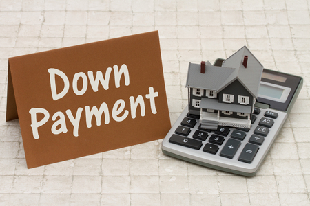 Home Mortgage Down Payment, A gray house, brown card and calculator on stone background with text  Down Payment