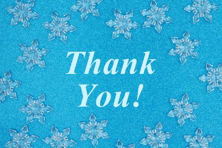 Foto für Thank you message with snowflakes on a blue glitter paper - Lizenzfreies Bild