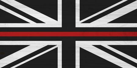 Foto de British thin red line flag with wood texture for a fire department background - Imagen libre de derechos