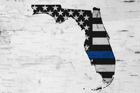 Foto de American thin blue line flag on map of Florida for your support of police officers - Imagen libre de derechos