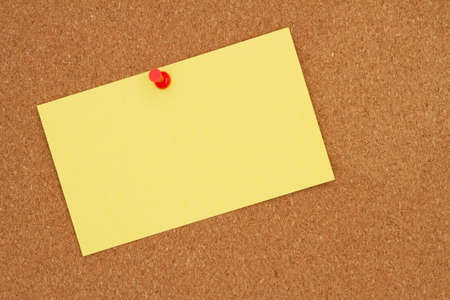 Photo for Retro yellow paper index card with pushpin on corkboard with copy space for your message - Royalty Free Image