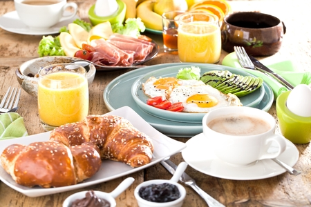 Homemade delicious american breakfast on dark wooden table