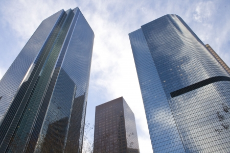 Downtown Los Angeles, three buildings reflecting clouds