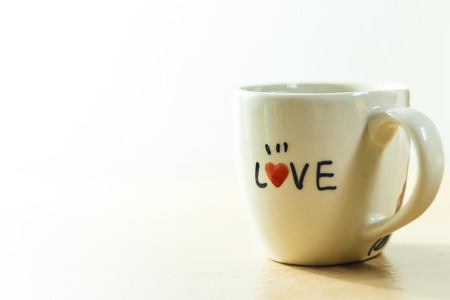 love alphabet on white cup photo stock