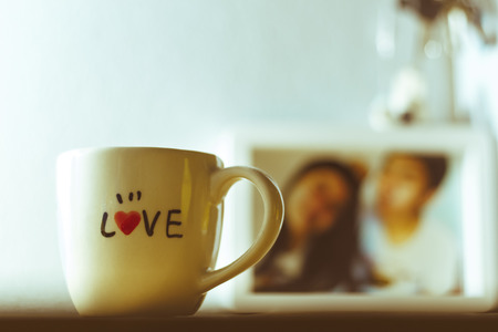 love alphabet on white cup vintage style photo