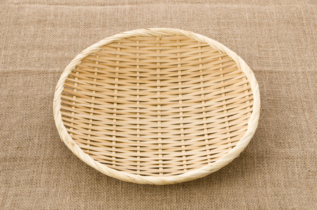 Photo pour bamboo Sieve on Burlap background - image libre de droit