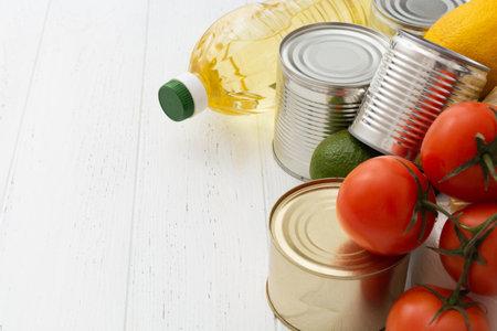 Photo pour Various foodstuff on white wooden table. Food donation - image libre de droit