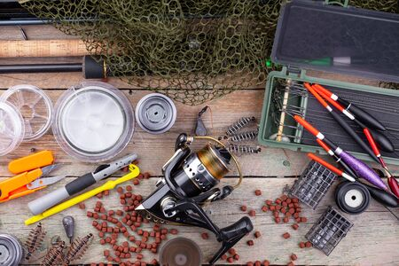 Photo pour fishing tackle on a wooden table. toned image - image libre de droit