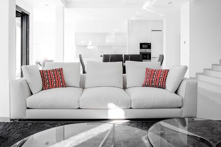 Photo pour Luxurious and modern living room, dining room and kitchen. Luxurious furniture, sofa, table and chairs. - image libre de droit
