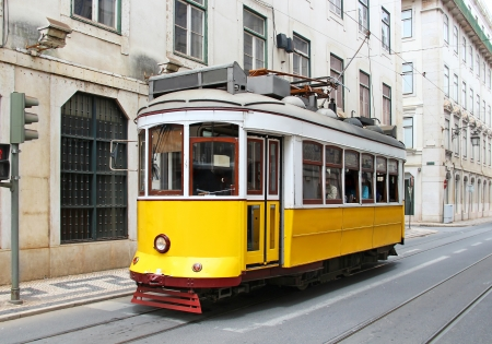 Old yellow tram in Lisbon downtown, Portugal