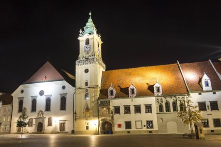 Photo for Old town hall (Stara radnica) and Jesuit church on the main square (Hlavne namestie) of Bratislava at night, Slovakia - Royalty Free Image