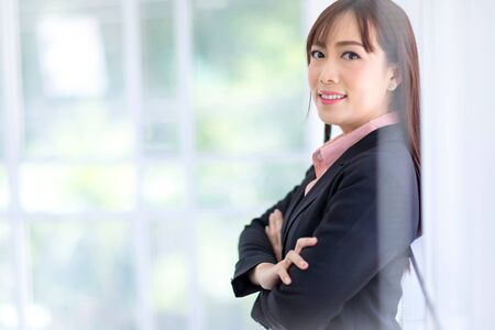 Foto de Beautiful Asian businesswomen wearing a black suit is smiling confidently and looking at the camera. Asian Business owners and office staff Concept - Imagen libre de derechos