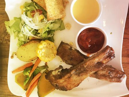 Roasted pork steak in a dish.