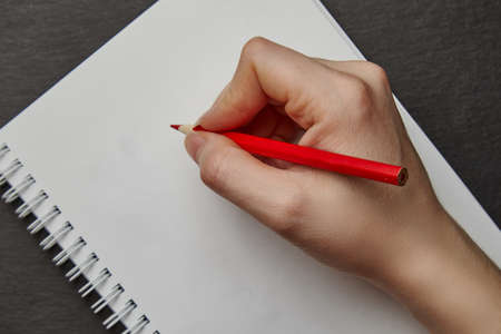 Photo for hand writing on notebook with wood pencil - Royalty Free Image