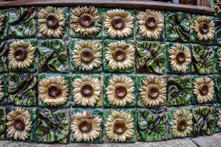 Comillas, Spain - August 24, 2016: La Villa Quijano, popularly known as El Capricho, is a modernist building in Comillas. Designed by Antoni Gaudi Detail ceramic floral motif with sunflowers