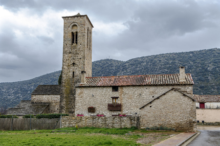 Virgen del Rosario Church in the rural town of Triste Aragon, Spain. Its Romanesque tower from the beginning of the XIII century
