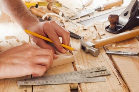 Photo pour carpenter working,hammer,meter and screw-driver on construction background - image libre de droit