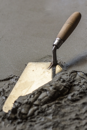 trowel  with wet concrete floor, construction tools