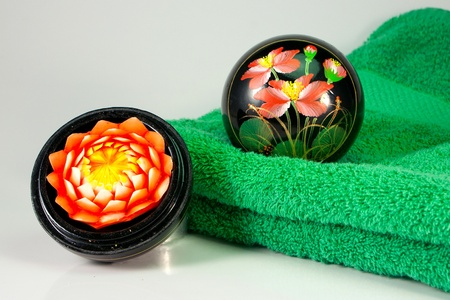 Aromatic blossom candle and green towel