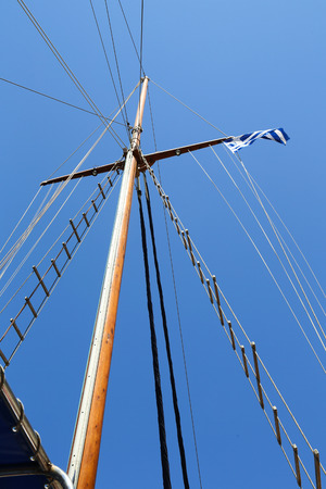 Mast of Sailing boat without sails and a blue sky
