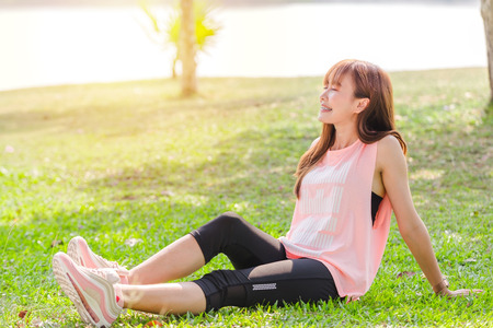 Foto de Asian beautiful young woman relaxing excercise in park - Imagen libre de derechos