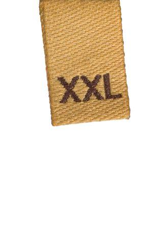 Macro of XXL size clothing label, isolated on white