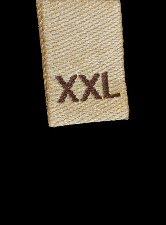 Macro of XXL size clothing label, isolated on black