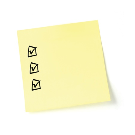 Yellow post-it sticker checklist, black check boxes and tick marks, isolated, blank post-it to-do list sticky note