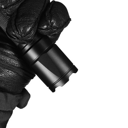 Gloved Hand Holding Tactical Flashlight, Bright Light Emiting Brightly Lit, Serrated Strike Bezel, Black Grain Leather Glove And Cop Jacket, Large Detailed Isolated Vertical Closeup, Patrolling Police Security Guard Staff Policeman, Covert Operations Patr