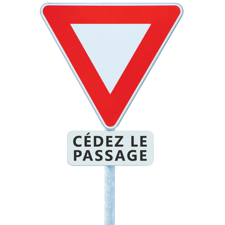 Give way yield french cédez le passage road sign, France, isolated vertical macro closeup, white signage triangle red frame regulatory warning, metallic pole post, panneau signalisation cédez-le-passage, large vehicle traffic priority roadsign signpost concept