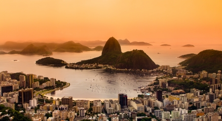 Rio de Janeiro, Brazil. Suggar Loaf and  Botafogo beach viewed from Corcovado at sunset.
