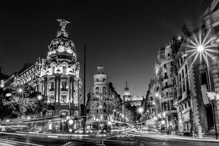 Rays of traffic lights on Gran via street, main shopping street in Madrid at night  Spain, Europe