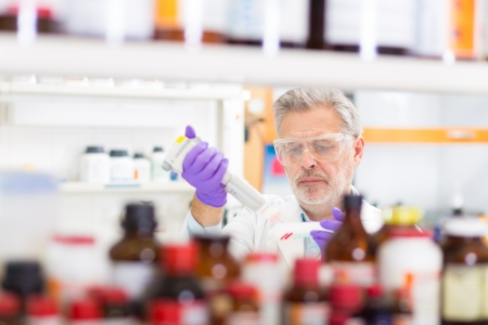 Life scientist researching in the laboratory. The life sciences comprise fields of science that involve the scientific study of living organisms, such as microorganisms, plants, animals, and human beings, as well as related considerations like bioethics.