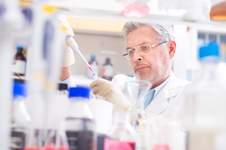 Life scientist researching in laboratory. Life sciences comprise fields of science that involve the scientific study of living organisms: microorganism, plant, animal and human cells, genes, DNA