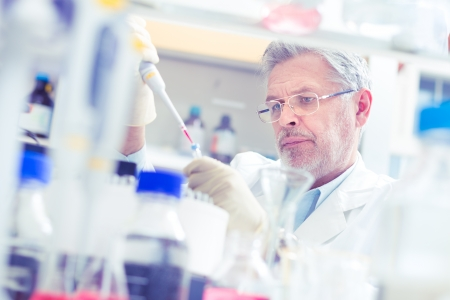 Life scientist researching in laboratory. Life sciences comprise fields of science that involve the scientific study of living organisms: microorganism, plant, animal and human cells, genes, DNA...