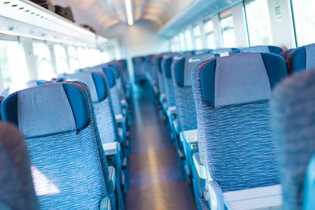 Modern european economy class fast train interior  Inside of high speed train compartment