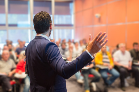 Photo pour Speaker at Business Conference with Public Presentations. Audience at the conference hall. Entrepreneurship club. Rear view. Horisontal composition. Background blur. - image libre de droit