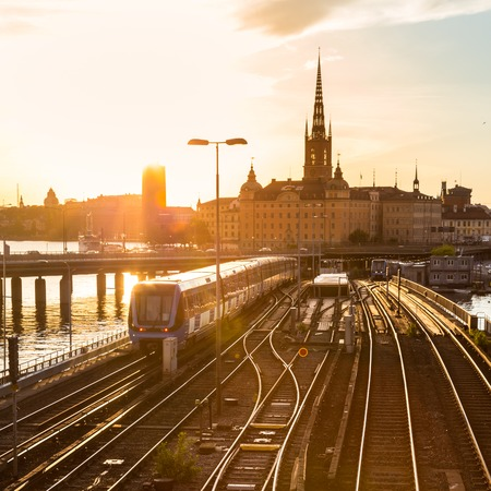 Photo pour Railway tracks and trains near Stockholm\'s main train station in Norrmalm area, Stockholm, Sweden in sunset.   - image libre de droit