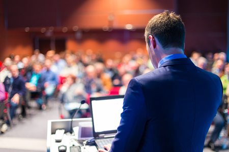 Photo pour Speaker at Business Conference with Public Presentations. Audience at the conference hall. Entrepreneurship club. Rear view. Horisontal composition. Background blur. - image libre de droit