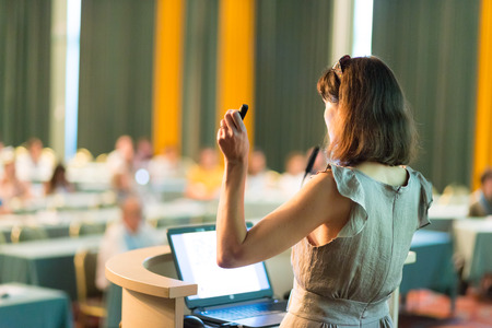 Business woman. Female speaker giving a talk at  business conference . Business and Entrepreneurship concept. Horizontal composition.