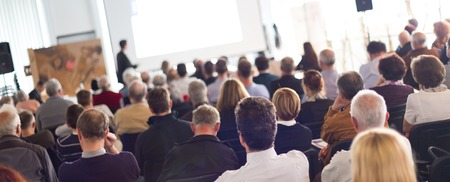 Photo pour Speaker Giving a Talk at Business Meeting. Audience in the conference hall. Business and Entrepreneurship. Panoramic composition suitable for banners. - image libre de droit
