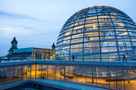 Illuminated glass dome on the roof of the Reichstag in Berlin in the late evening.