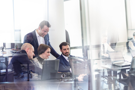 Photo for Workplace in modern office with business people brainstorming. Businessman working on laptop during the meeting. - Royalty Free Image