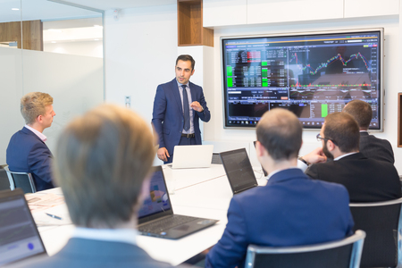 Photo pour Businessman giving a talk in conference room. Business executive delivering presentation to business partners during business meeting. Corporate business concept. - image libre de droit