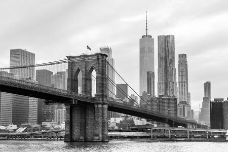 Brooklyn Bridge and Manhattan skyline in black and white, New York City, USA.