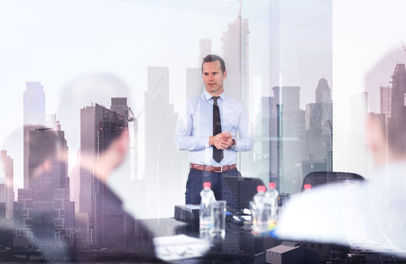 Photo pour Corporate business, economic development or real estate company concept. Confident company leader on business meeting against new york city manhattan buildings and skyscrapers window reflections. - image libre de droit