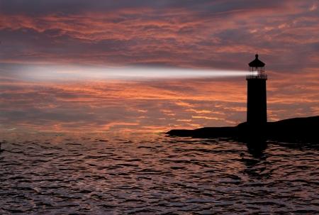 Photo pour Lighthouse searchlight beam through marine air at night  - image libre de droit